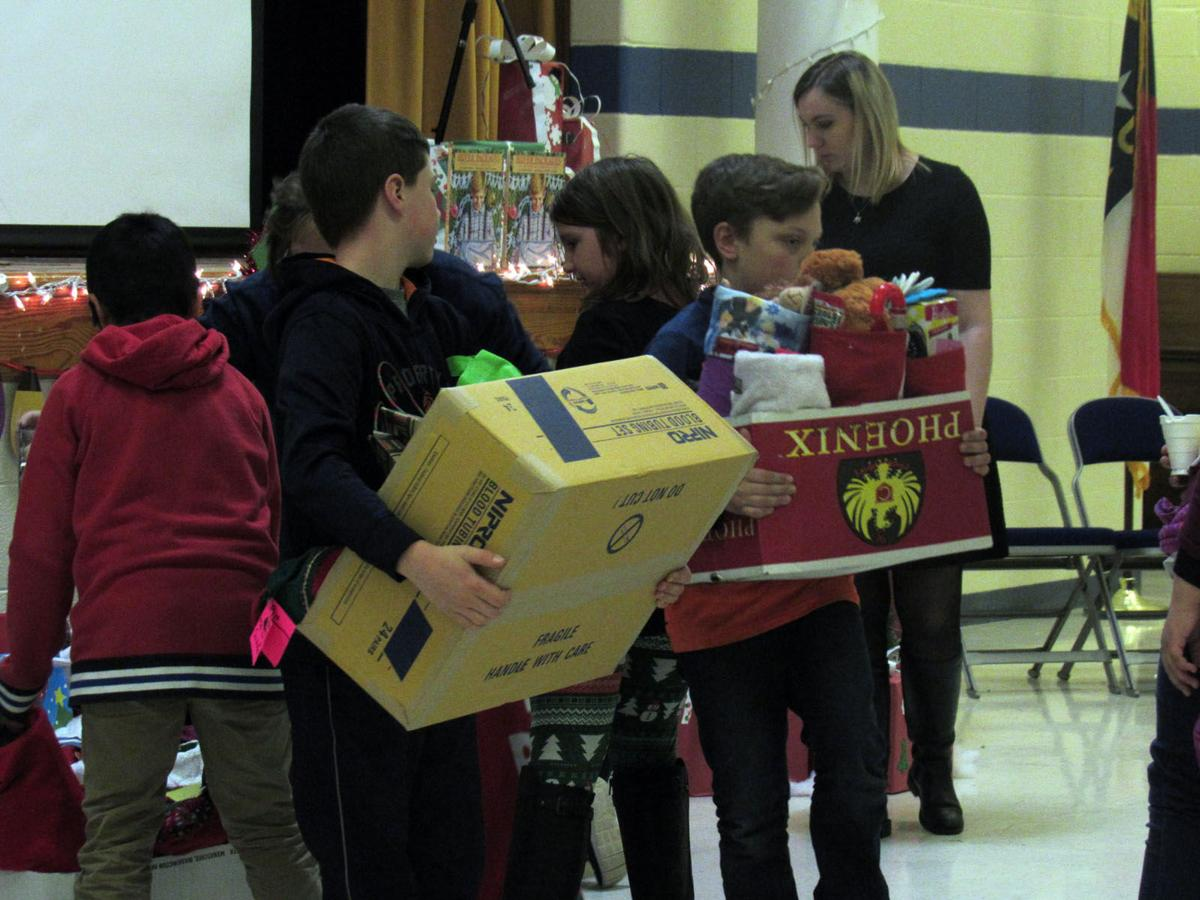 P.G., Old Fort students bring cheer to foster care kids