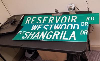 Vandals, thieves target road signs