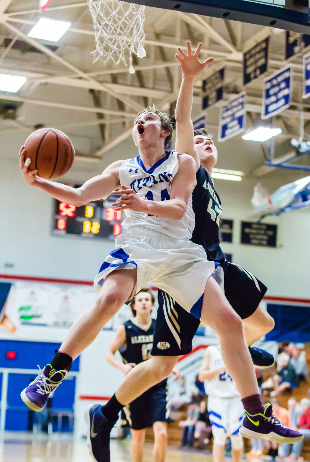 Titans avoid mauling by Cougars, advance to NWC semifinals