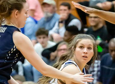 Lady Titans slide past Cougars