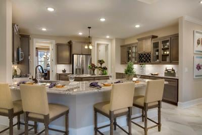 042121_MNS_Parade_Homes_002 Spruce model home kitchen at Cresswind Peachtree City by Kolter Homes
