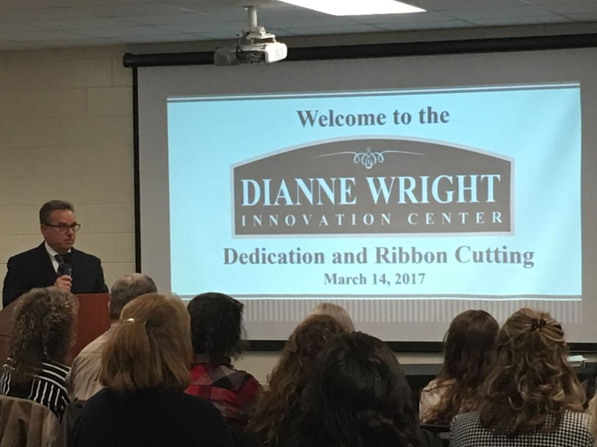 Superintendent Cliff Cole speaks during the dedication of the school  district's Dianne Wright Innovation Center in April.