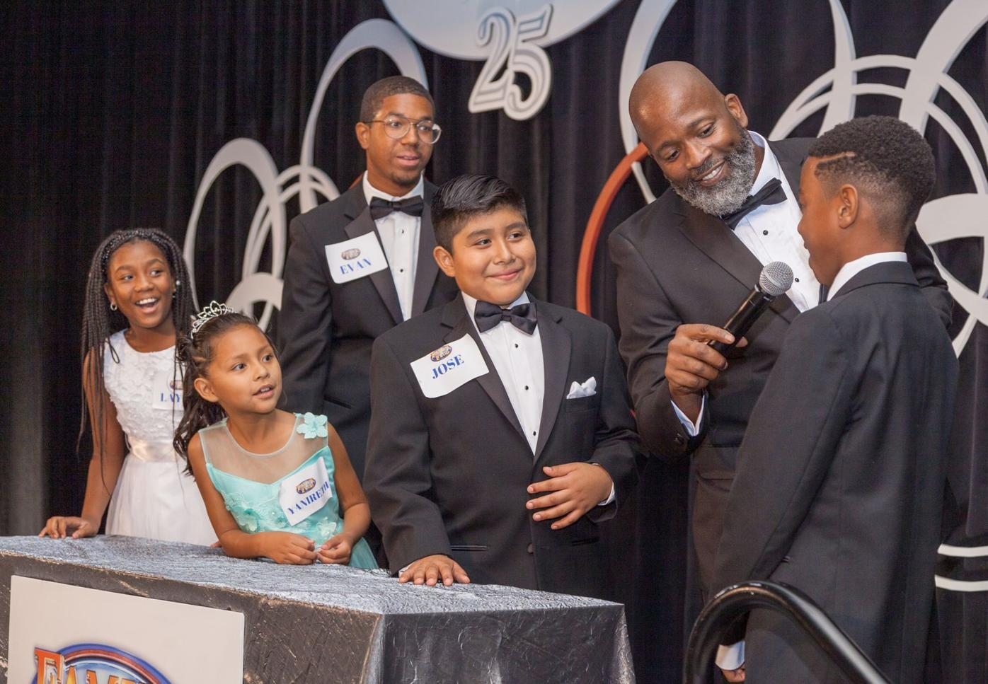 "100219_MNS_full_Legacy_Awards_002 children with Cory ""Zooman"" Miller playing Family Feud"