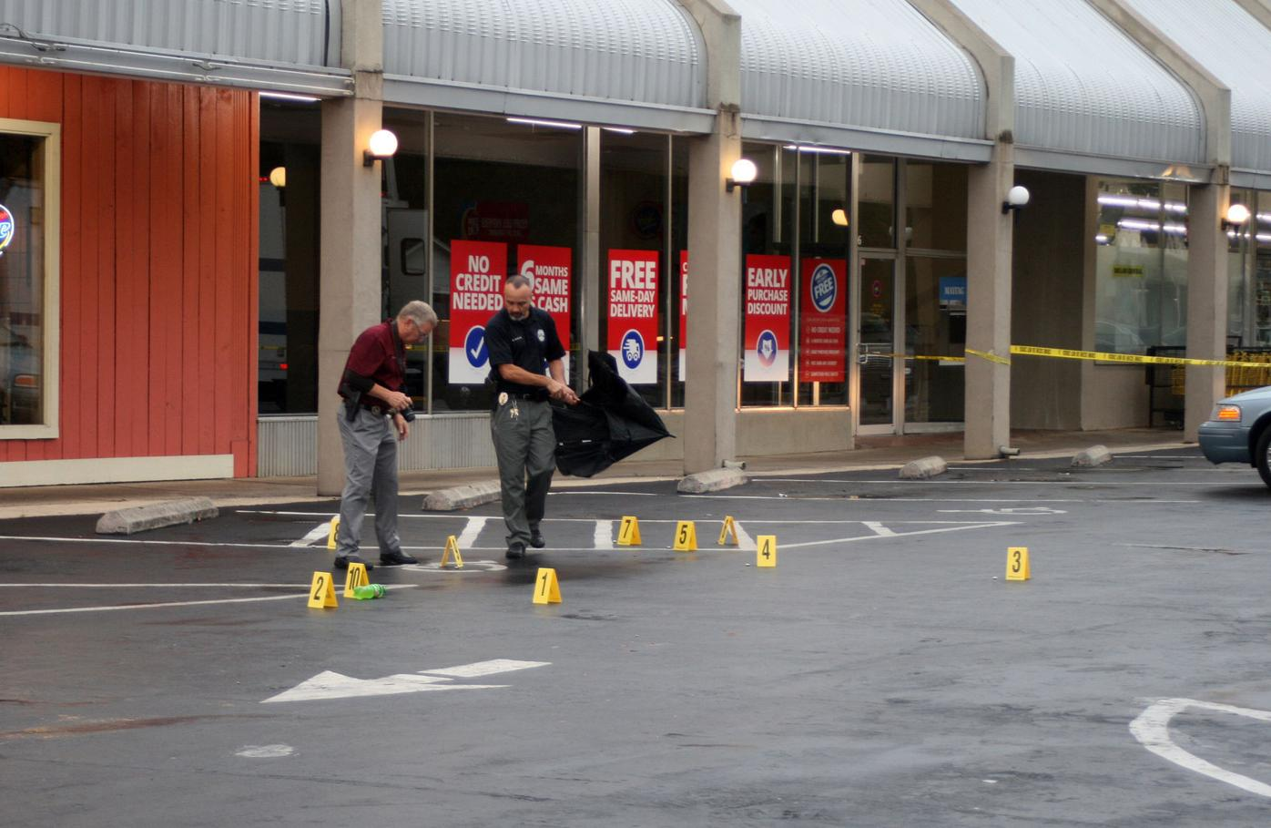 Investigators scan scene of shooting