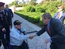 06-06-19 JHI shakes hand of WWII veteran.jpg