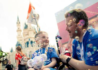 070319_MNS_Berts_Adventure_noms boy with Tommy Owens at Walt Disney World