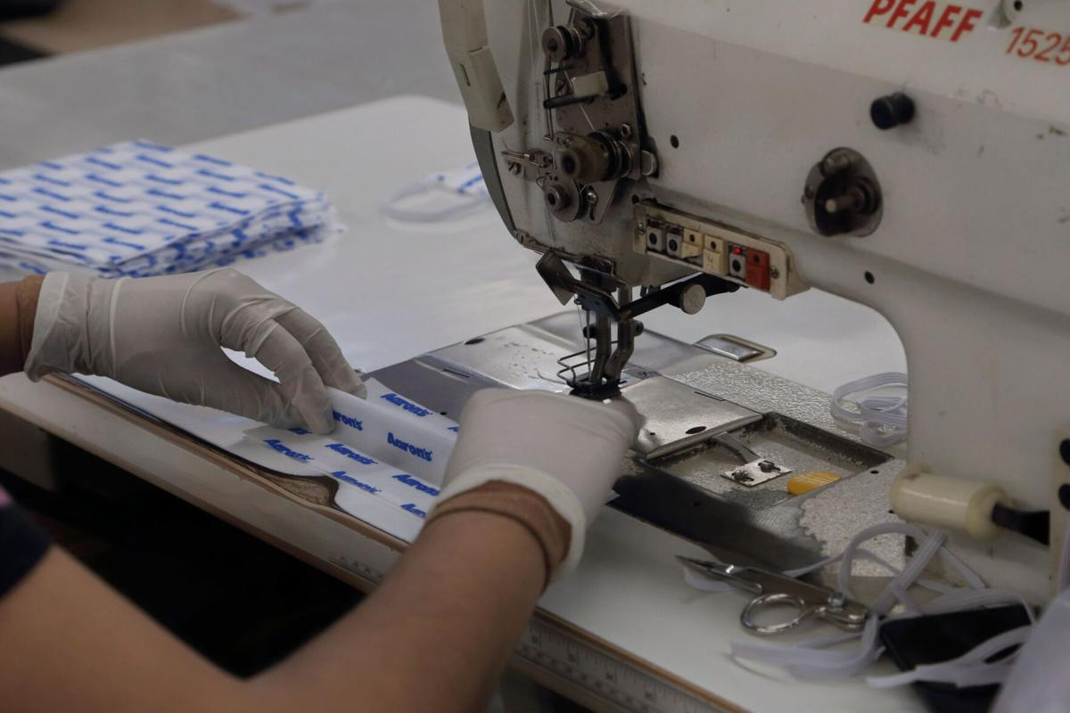 061020_MNS_Aarrons_PPE_002 Aaron's Inc. worker at sewing machine