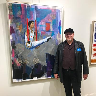 Artist Steven Lester with one of his Olympic-themed paintings