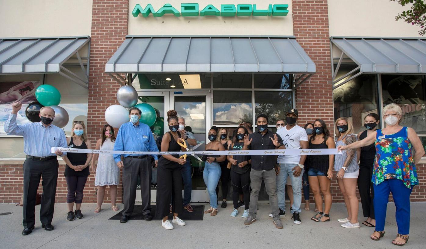 081220_MNS_MADabolic_001 LaShell Estes with group at ribbon cutting
