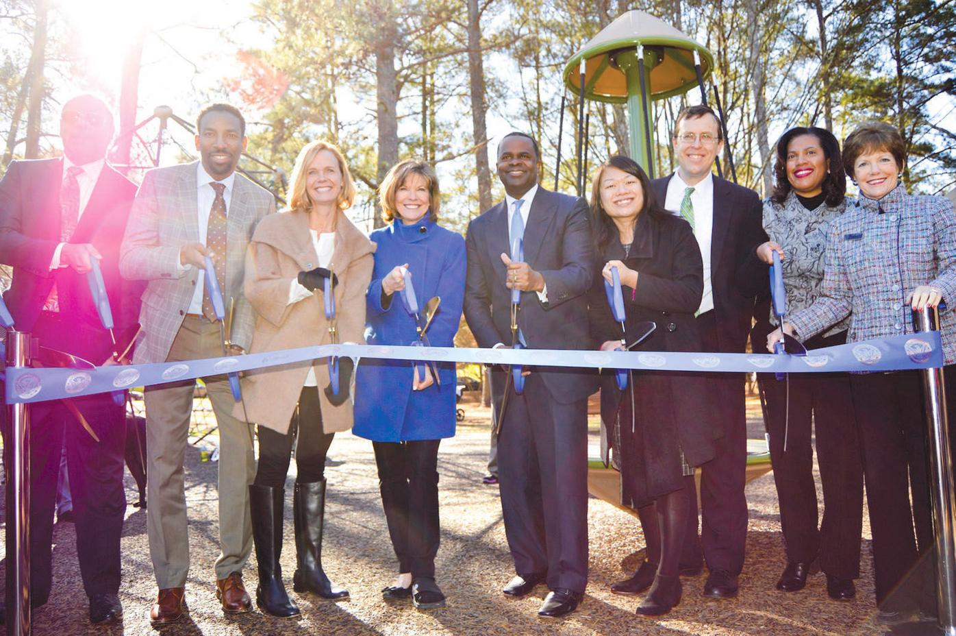 Full playground opens 1 group at ribbon-cutting ceremony