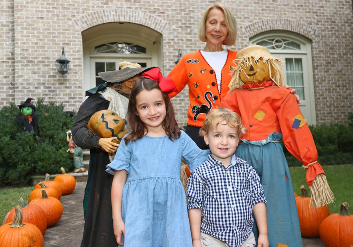Halloween tradition 1 Sarah Hagood with children and pumpkins
