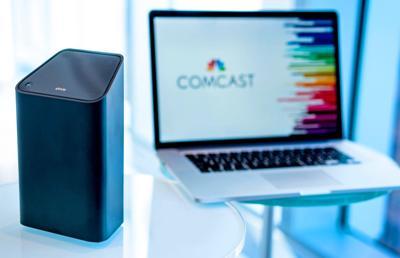 100919_MNS_Comcast_Internet modem and laptop