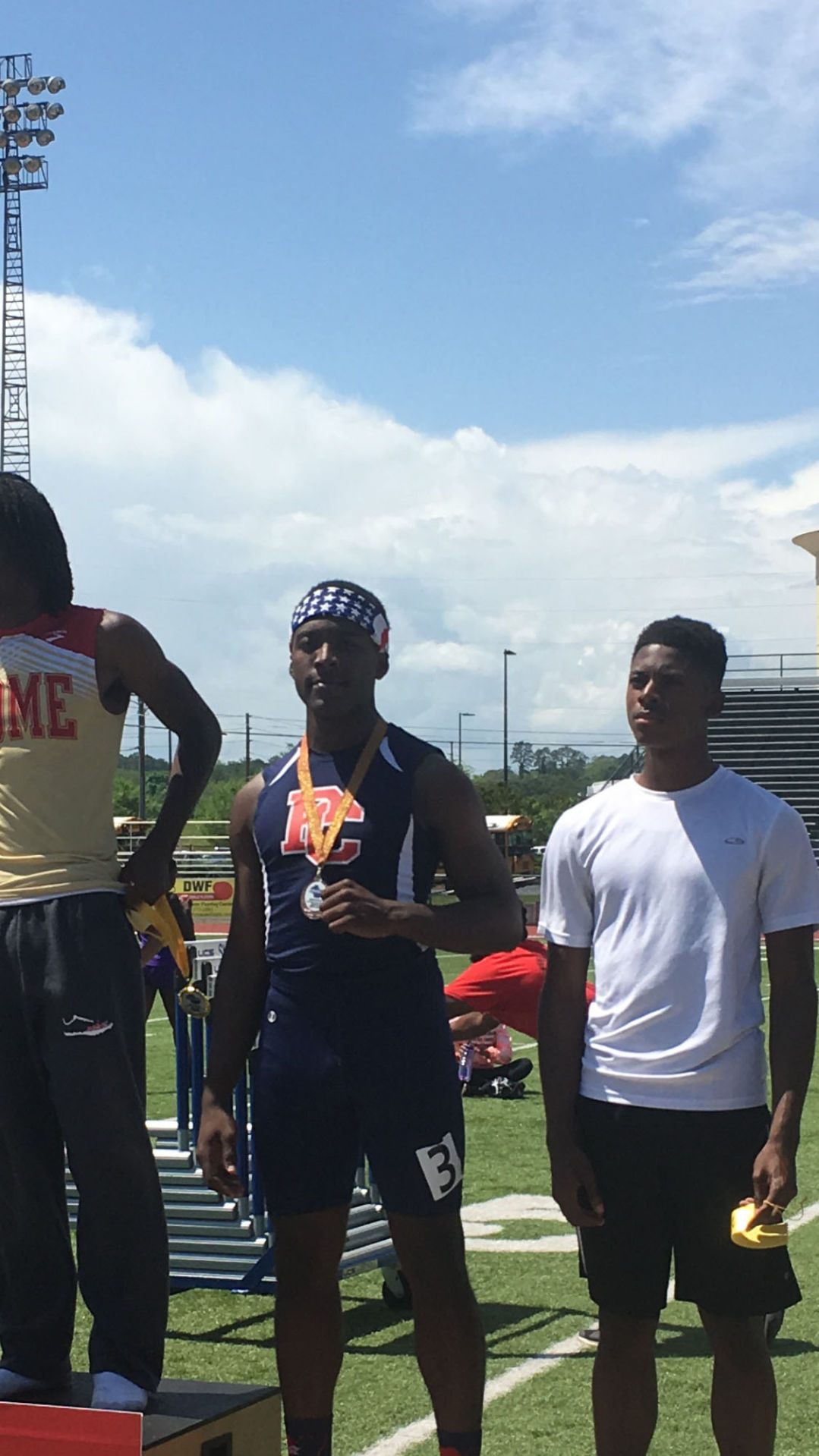 Paulding County High sprinter Cam Pittman, center, is shown at the recent  Region 7-AAAAA meet in Rome.