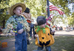 10-17-15 --HARVEST FEST-- Four-year-old Jackson Goodwin, left, and his two-year-old Jacob pick out prizes after winning a game during the 39th annual Harvest Fest on the Marietta Square. / Staff-Kathryn Ingall