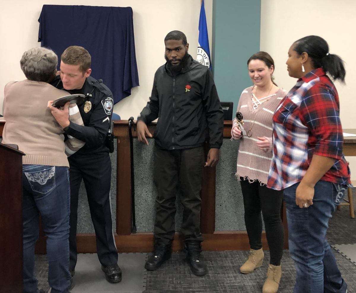 Shooting victim presents officer, dispatcher with awards