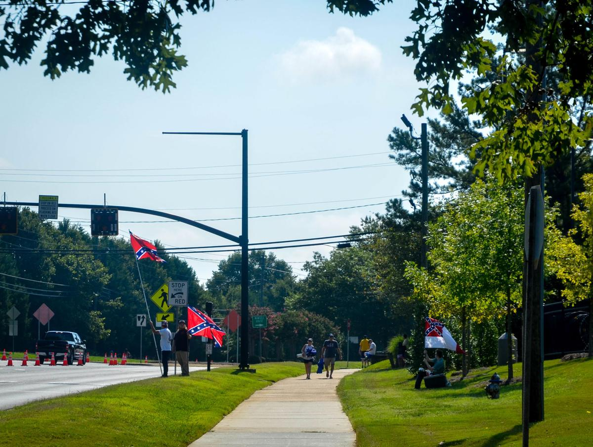 Parade Goers fly confederate flag