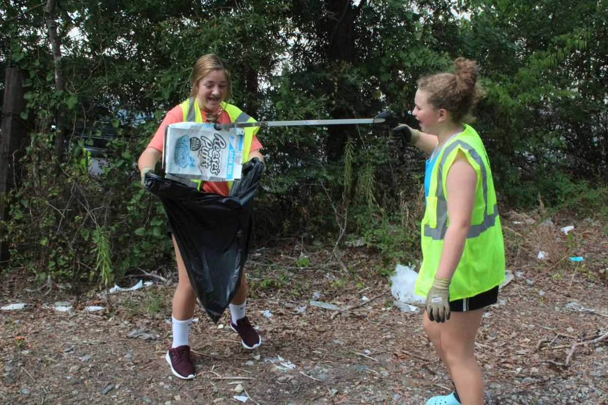 Youth group helps clean up illegal dumping site