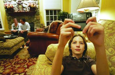 Parents set texting, computer limits in digital age
