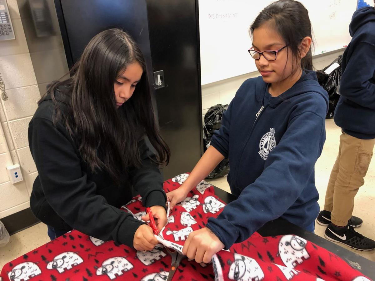 Dec 14 - Marietta 6th Grade Academy working on Fence Knot Blankets - Pic#1 (1).jpg
