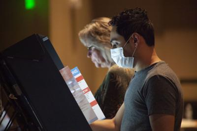 Voter at touchscreen machine