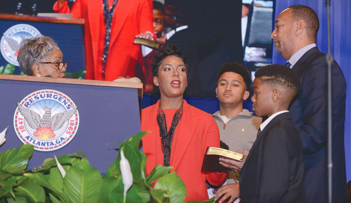 Atlanta swearing in 1 Keisha Lance Bottoms with family and Brenda Cole