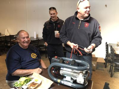 YMCA group donates air compressor to the fire department