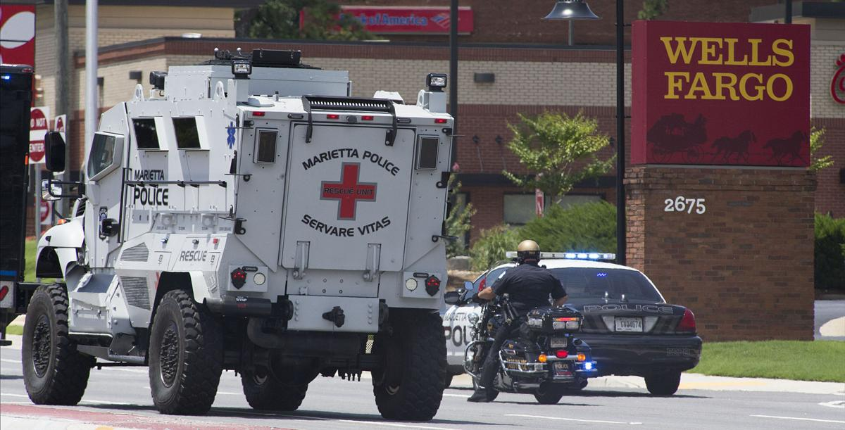 Man claiming to have bomb in Windy Hill Road bank dies after
