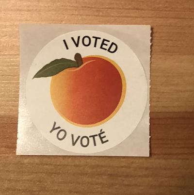 Voting sticker English and Spanish