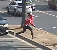 54653 pm suspect running to his vehicle_.PNG