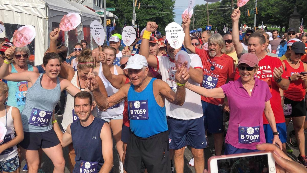 The AJC Peachtree Road Race sees record-setting runs on