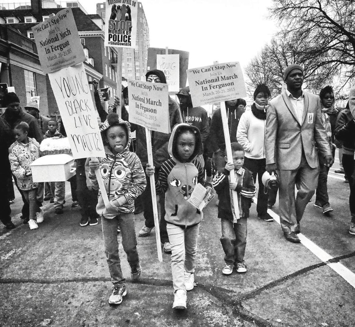 High Civil Rights 2 children carry protest signs in Ferguson