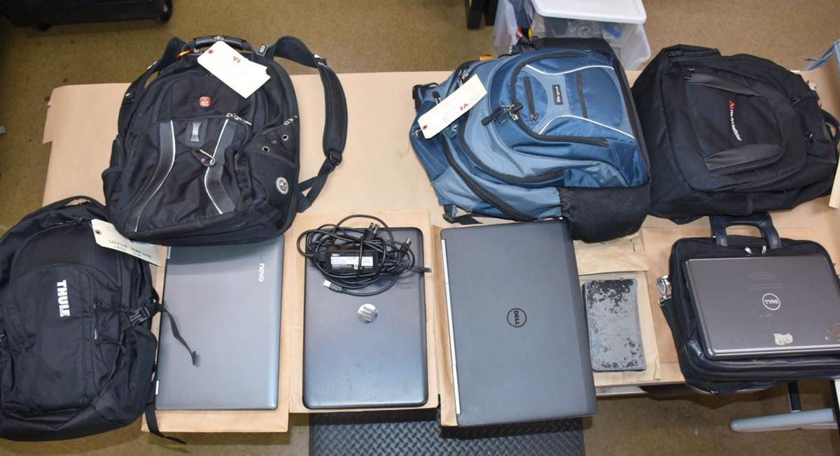 010120_MNS_breakin_bust_001 backpacks and laptops