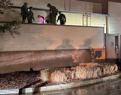 030321_MNS_Sandy_burglar Jah'msid Nieem Ci'heed Johnson with North Metro SWAT team