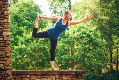 instructor combines yoga pilates into single exercise