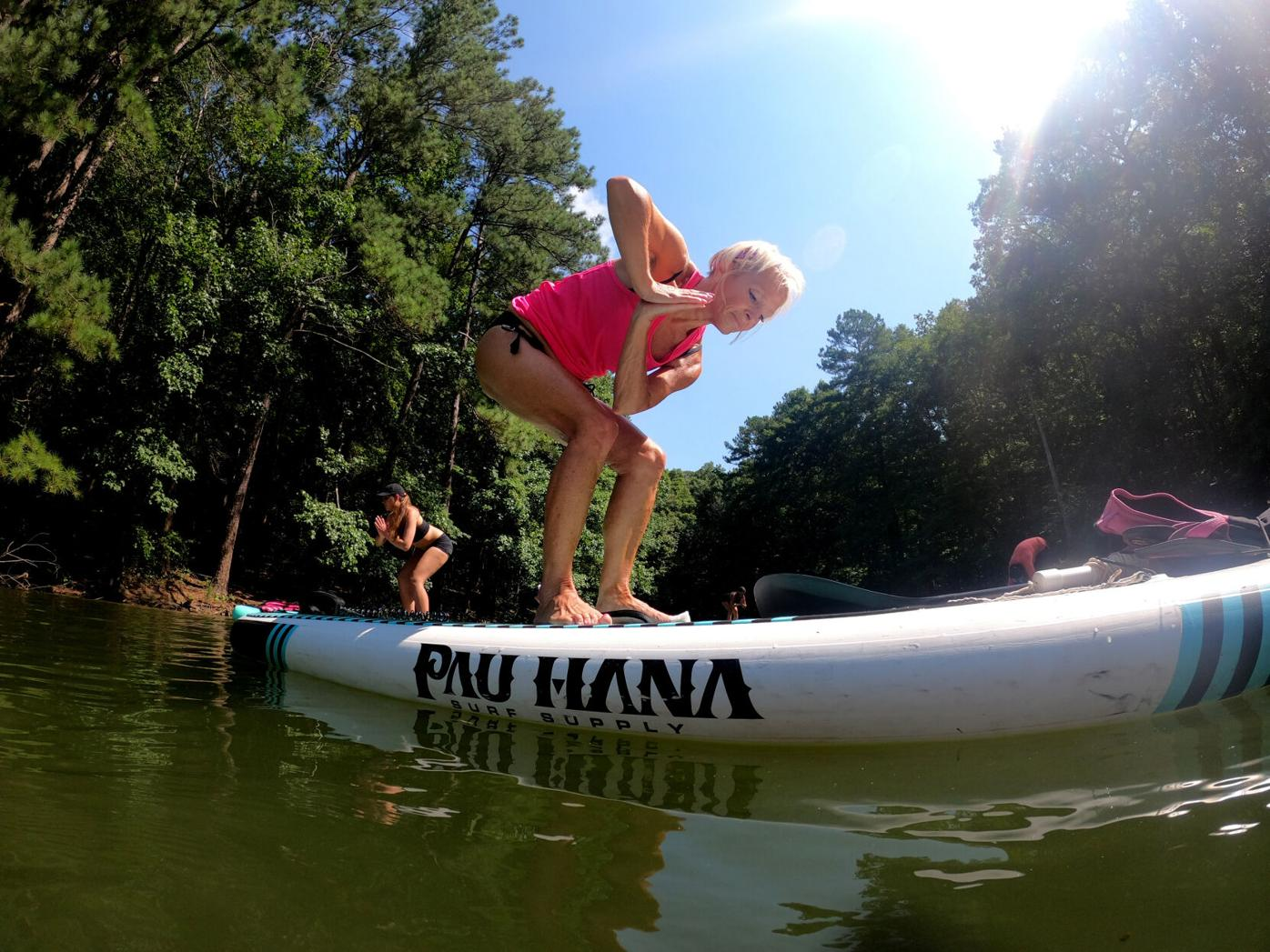 Standup paddleboard yoga grows in popularity during pandemic