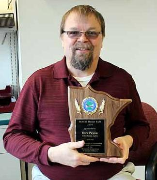 Aitkin County Auditor Kirk Peysar with the plaque awarded to him by the Minnesota Association of County Officers.
