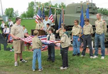 Aitkin Boy Scouts show how to fold a flag.
