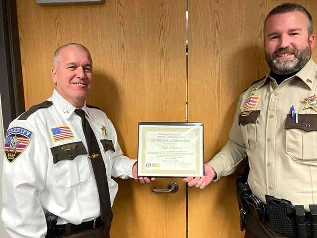 Mille Lacs County Sheriff Don Lorge congratulated Sgt. Kyle Burton