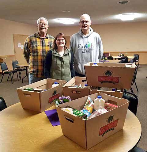 Dennis Boser, Pastor Kate Mensing and Mark Menke