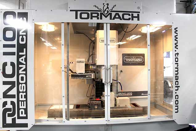 CNC machine is linked to a computer that is programmed to cut specific parts with precision.