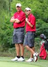 Grant Exsted and college coach Jim Socha.