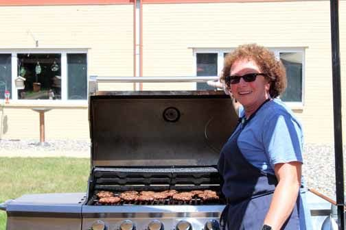 Priscilla Bloom grilled burgers for residents at last week's picnic.