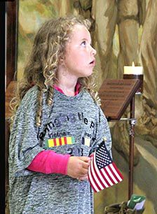 Karen Reid, president of the McGregor VFW Auxiliary, submitted this photo taken by Pamela Linkert of her granddaughter Maggie visiting the Moving Wall at Mora.
