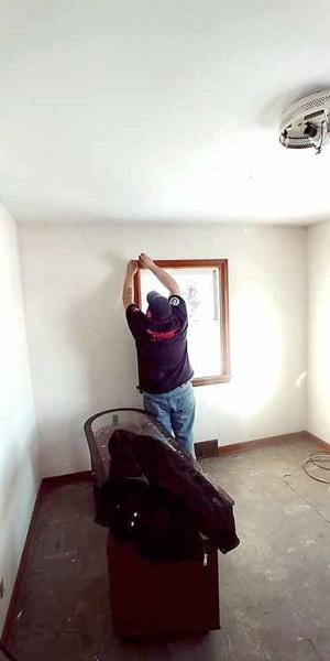 Nick Dinger works to prepare a womens' recovery house for residents.