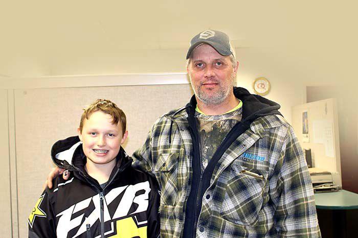 Jace Shaw with dad Ryan Shaw, proprietor of Pristine Concrete in Aitkin.