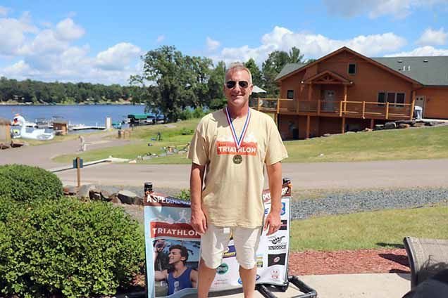 Top individual finisher in the kayak, bike and run category