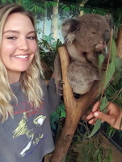 CLC alumna Kylie Geatz with a koala bear.
