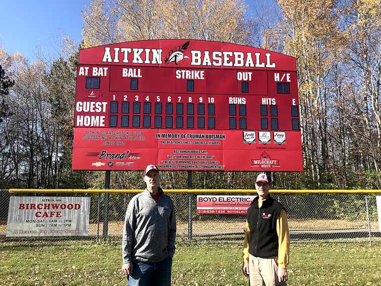 John and Terry Buisman pose by the scoreboard