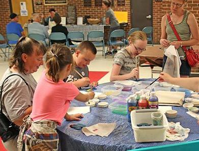 Children and adults caught some fun at the fish painting table.