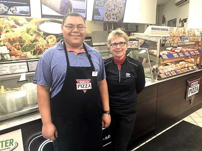 Chris Washington and Mary Turk are pictured at Aitkin's Holiday Station store.